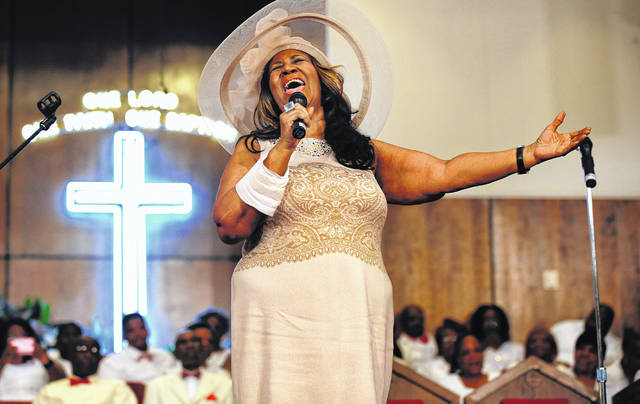 In this June 7, 2015 file photo, Aretha Franklin sings during a memorial service for her father and brother, Rev. C.L. and Rev. Cecil Franklin, at New Bethel Baptist Church where they were ministers, in Detroit, Mich. Franklin died Thursday, Aug. 16, 2018 at her home in Detroit. She was 76.
