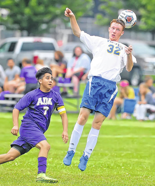 Miller City's Nick Gable heads the ball over Ada's Christopher Reyes during Monday's match at Ada War Memorial Park.