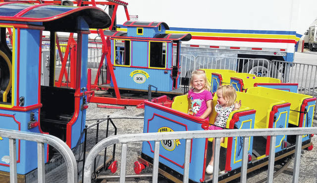 Kierstyn Garber, left, and Kylie Garber enjoy a trip around the tracks during last year's fair.