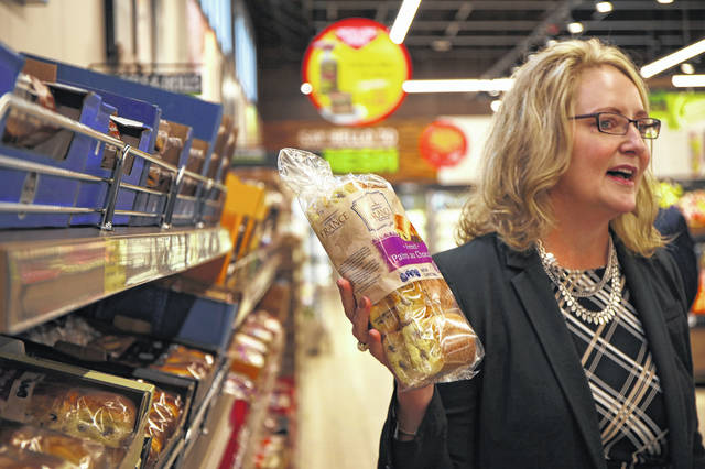 Joan Kavanaugh, vice president of corporate buying for Aldi U.S., speaks about changes in the bread department it its stores at the Aldi Store in St. Charles, Illinois, on Wednesday. The company is tweaking its formula with remodels at existing stores and a rollout of new stores, including one being built along Harding Highway on Lima's east side.