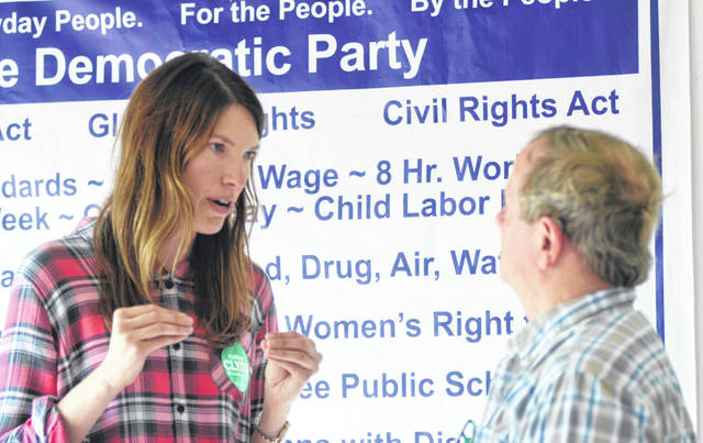 State Rep. Kathleen Clyde, candidate for Ohio Secretary of State, speaks to a local resident visiting the Allen County Democrat booth.