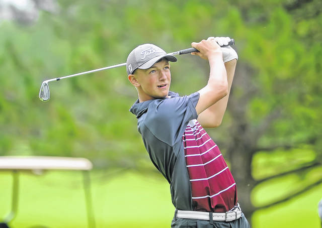 Kalida's Christian Nartker watches his tee shot on the 13th hole during Tuesday's The Allen East/Colonial Golfers Club tournament in Harrod.