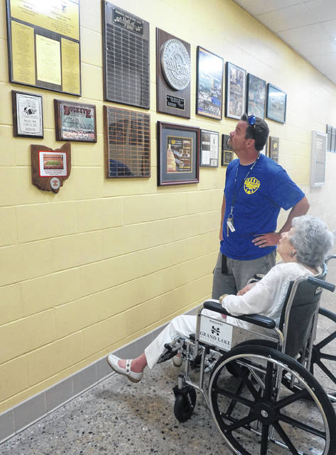 Sue Hoge, 98, and Band Director Craig French view St. Marys MHS Band Hall of Fame plaque engraved with her name.