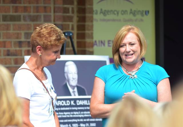 Dee Kemp, left, and CEO Jacqi Bradley, right discuss the impact Kemp's father, Harold Dahill, had on the agency.