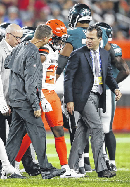 Cleveland Browns defensive back Denzel Ward is walked off the field during the first half of an NFL preseason football game against the Philadelphia Eagles on Thursday night.