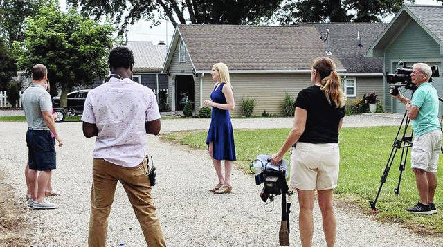 Left Right LLC production company films a scene with island homebuyers the Gibbses from Dayton and local Realtor Paige Duff (center).