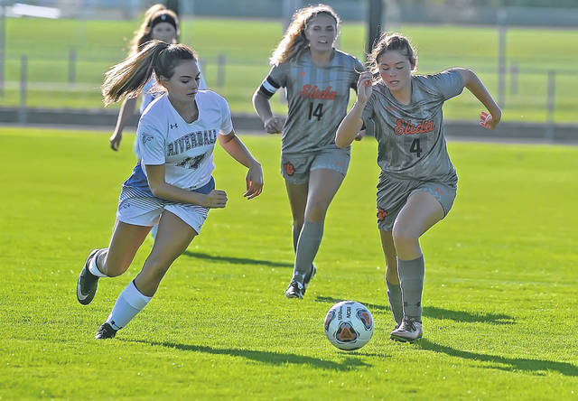 Elida's Marley Savill, right, battles for the ball with Riverdale's Elizabeth Burd during Wednesday's match at the Elida Sports Complex. See more match photos at LimaScores.com.