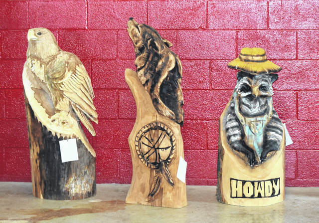 Elaborate wood sculptures crafted with a chainsaw were sold at the 4-H auction Saturday at the Allen County Fair.