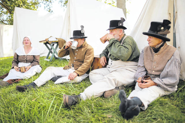 Participants in the reenactment of the War of 1812 pose.