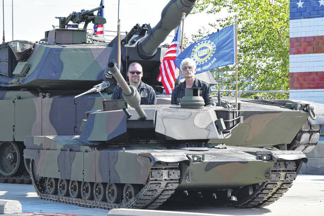 Fielden Wireman and George Jeffries sit in Half Pint, a half scale version of the Abrams Main Battle Tank produced at Joint Systems Manufacturing Center in Lima.