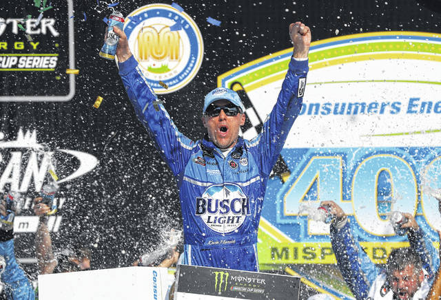 Kevin Harvick celebrates his victory after a NASCAR Cup Series auto race at Michigan International Speedway in Brooklyn, Mich., on Sunday.	It was his seventh win this year.