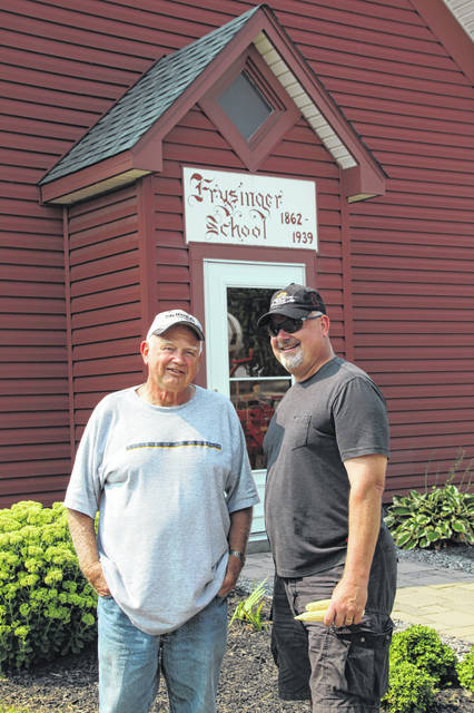 Lowell Davis and his son, Vaughn, farm the land where the Frysinger School stands. This one-room schoolhouse was built in 1862 and has become central to Vaughn Davis' business.