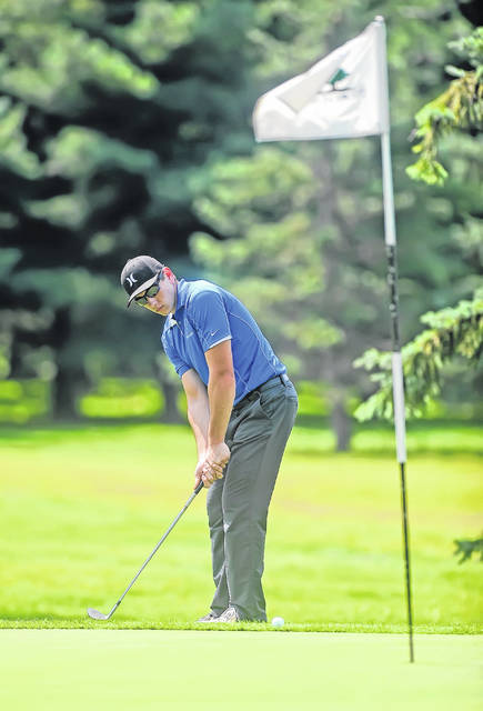 Allen East's Nick Phillips, who finished with a 103, chips onto the first hole during Monday's Liberty-Benton Invitational at Sycamore Springs in Findlay.