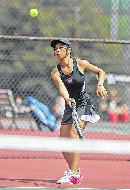 Shawnee's Alotus Wei hits a return during Saturday's Lima City Tournament at Collett Street Courts.