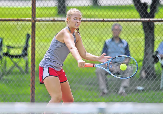Lima Central Catholic's Olivia Kesner hits a return during Saturday's Lima City Tournament at Collett Street Courts.