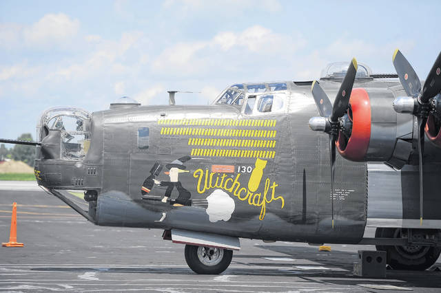 "The World War II-era B-24 Liberator bomber ""Witchcraft"" landed Wednesday at the Allen County Airport as part of a vintage aircraft tour. This plane is the last B-24 still flying."