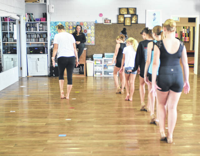 Lyn's Academy of Dance instructor Crista Howard demonstrates choreography for a new routine for the competition students at the dance studio on 101 Pioneer Road.