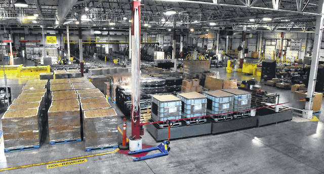 Damaged pallets are reworked to avoid waste at the Lima Procter & Gamble plant, which is one of just five factories in the fabric care industry nationwide to rely entirely on renewable energy for its production process.