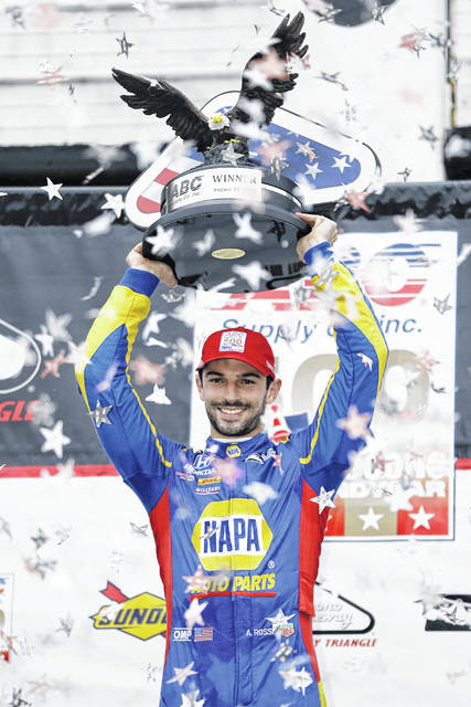 Alexander Rossi poses in Victory Lane after winning the IndyCar auto race at Pocono Raceway, Sunday, Aug. 19, 2018, in Long Pond, Pa. (AP Photo/Matt Slocum)
