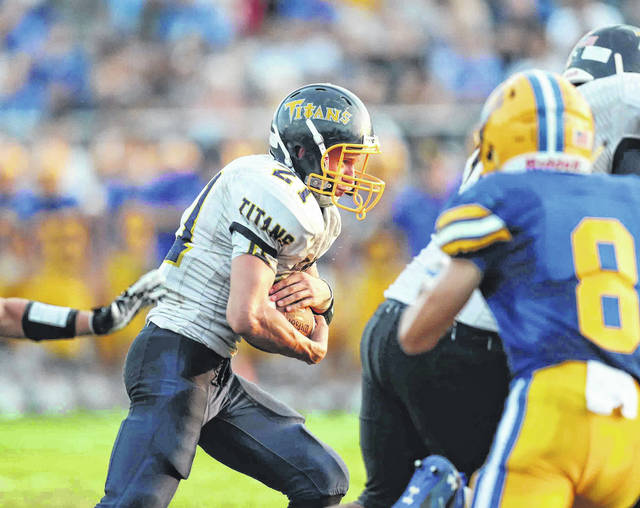 Ottawa-Glandorf's Clayton Recker looks for running room during Friday night's game at Skip Baughman Stadium in St. Marys.