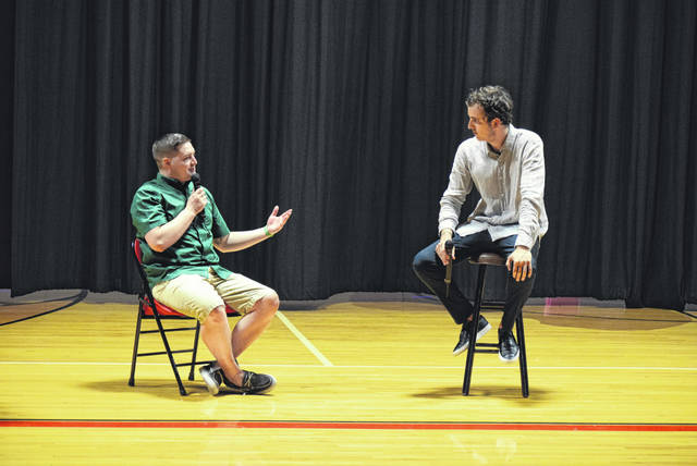 Zach Ricker, left, founder of S.H.Y.A.A. talks with Kevin Breel, a mental health activist and TED Talks presenter at an event Sunday night at Delphos Jefferson Middle School.