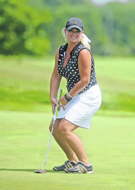 Jessica Whittaker reacts during a putt on the fourth hole during Saturday's 75th annual Lima Area Women's Match Play event at Hidden Creek Golf Club.