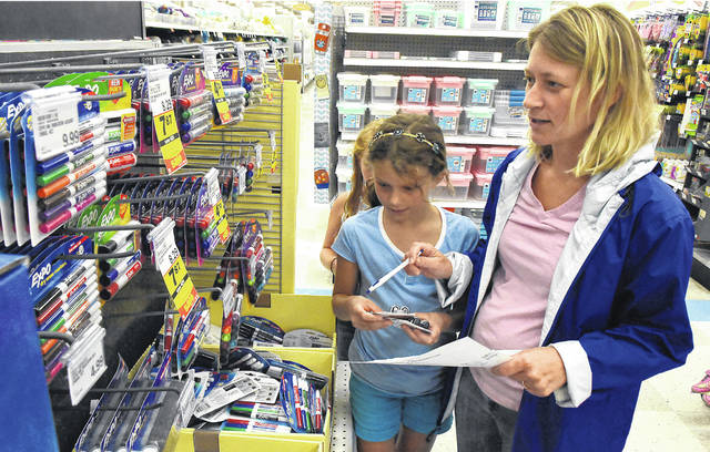 Joy Troyer of Elida, shops for school supplies for her children at Meijer in Lima.
