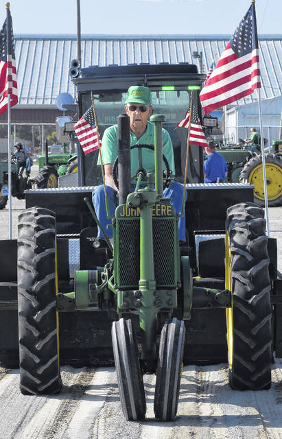 Mel Dawson, of Ada, competes in last year's tractor pull with his 1936 John Deere Model A tractor to win in his division.