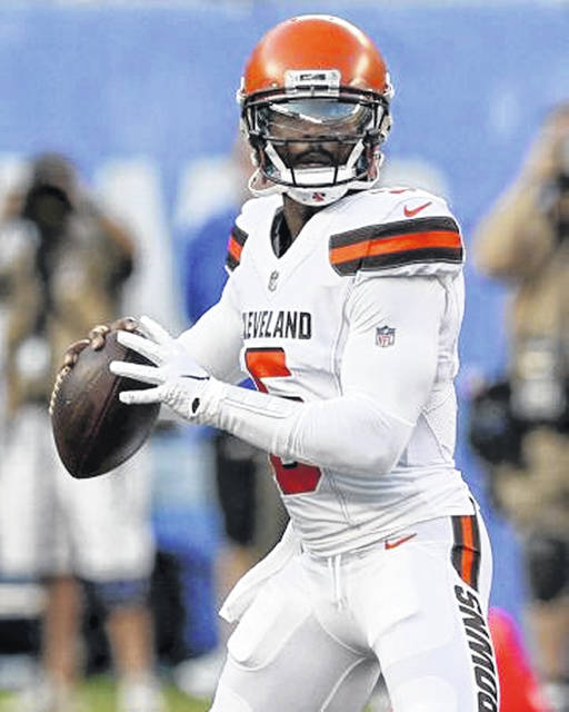 Cleveland Browns quarterback Tyrod Taylor (5) looks for a receiver during an exhibition game against the New York Giants on Thursday. Despite a good performance by Baker Mayfield, Browns quarterbacks coach Ken Zampese says Taylor will remain the starter.