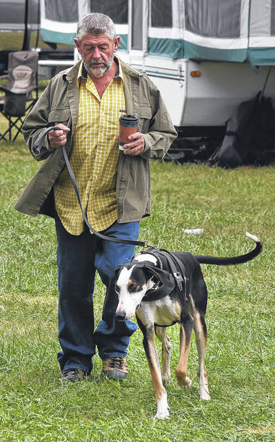 Denny Job walks a mixed-bred hound during Max's Trader Days & Water Dog Races in 2017. Job brought six dogs to last year's competition.