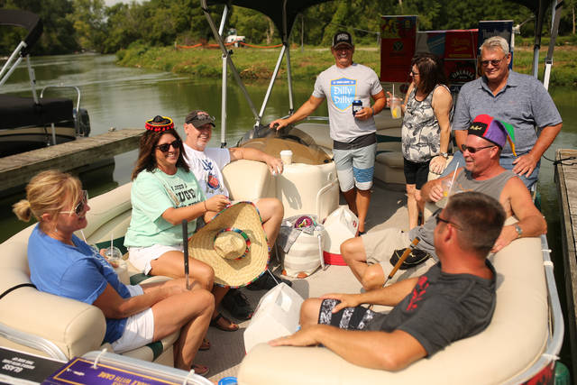 The Liquor Box crew enjoy their day of putt putt and boating at Shocker's in Monetezuma during the annual Bar Stool Open event on Saturday morning.
