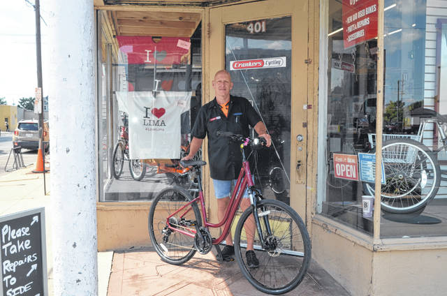 Crankers Cycling owner Kent Fultz sits on bike outside Crankers Cycling on 401 N. Main St.