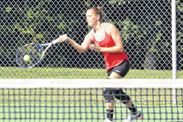 Playing No. 1 singles, Bluffton's Erin Hotmire hits a forehand return in a match against the Celina Bulldogs at the Bluffton courts. Hotmire picked up the win for the Pirates.