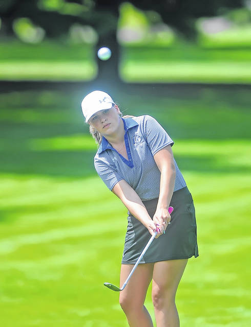Jennifer Mitchell chips onto the 11th green during Thursday's 75th Annual Lima Area Women's Match Play Tournament at Springbrook Golf Club.  Richard Parrish | The Lima News