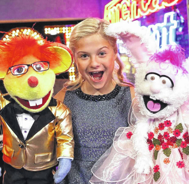 Darci Lynne Farmer performs with her puppets Oscar, left, and Petunia, right.