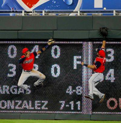 Cleveland Indians center fielder Greg Allen, left, and right fielder Melky Cabrera chase a walk-off home run by Kansas City Royals' Hunter Dozier during Friday's game in Kansas City, Mo. The Royals won 5-4. (AP photo)