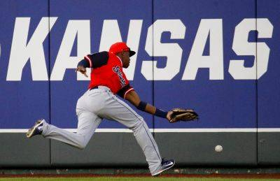 Cleveland Indians center fielder Greg Allen chases a double hit by the Royals' Salvador Perez during the fourth inning of Saturday night's game in Kansas City, Mo. (AP photo)