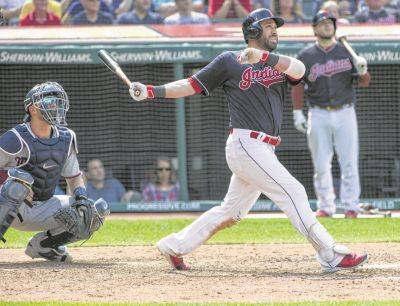 The Indians' Jason Kipnis and Minnesota catcher Mitch Garver watch Kipnis' three-run home run off Alan Busenitz during the sixth inning of Thursday's game in Cleveland.