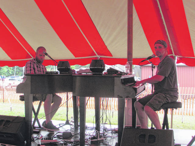 "Midwest Dueling Pianos was one of the featured bands playing last year at Little Nashville. Here they playing the Elton John Classic ""Rocket Man."""