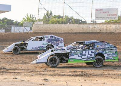 Jerry Bowersock (95) passes Curtis Diesenroth (2D) and Brandon Vaughan during Friday night racing at Limaland Motorsports Park.