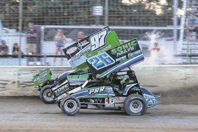 amie Miller (26) passes Kyle Peters on his way to victory Friday night at Limaland Motorsports Park.