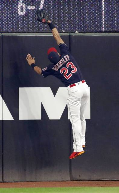 Cleveland Indians' Michael Brantley catches a ball hit by Minnesota Twins' Joe Mauer in the first inning of a baseball game, Tuesday, Aug. 7, 2018, in Cleveland. Mauer was out on the play. (AP Photo/Tony Dejak)