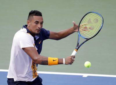 Nick Kyrgios, of Australia, returns a shot to Pierre-Hugues Herbert, of France, during their Thursday second round U.S. Open match in New York. (AP photo)