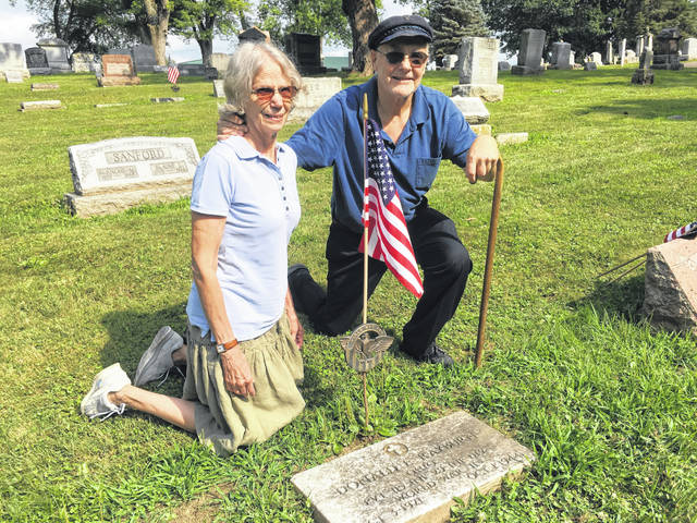 Kathleen and David Paxton are the driving force behind the Allen County Veterans Memorial Foundation. They are pictured at the grave of PFC Donald Rayburn of Lima, who was the subject of a poem by his wife, Naomi, after he was killed during WWII in Germany in 1944.