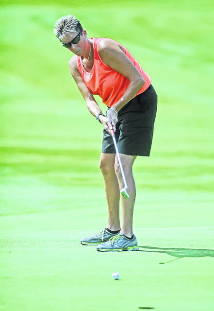 Amy Newland putts on the 14th hole during Thursday's 75th Annual Lima Area Women's Match Play Tournament at Springbrook Golf Club.  Richard Parrish | The Lima News