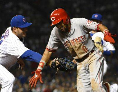 Cubs first baseman Anthony Rizzo tags out Cincinnati's Billy Hamilton before he can get back to the bag during Thursday night's game in Chicago. (AP photo)