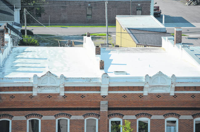The roof of Signature Design LLC. (left) is completely covered in a Dura-Last membrane while the roof of Signature Look Boutique has membrane on two thirds of roof . The back section is the same kind of roofing the Putnam County Courthouse currently has.