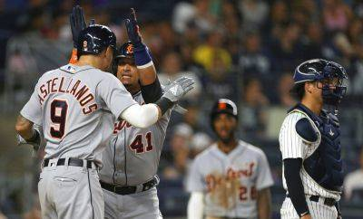 Detroit Tigers' Victor Martinez (41) celebrates with Nicholas Castellanos (9) after he hit a two-run home run against the New York Yankees during the ninth inning of Thursday night's game at Yankee Stadium in New York. The Tigers defeated the Yankees 8-7. (AP photo)
