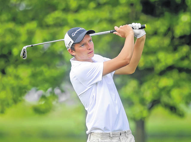Ottoville's Dylan Kemper watches his tee shot on the 11th hole during Wednesday's tri match at Delphos Country Club.