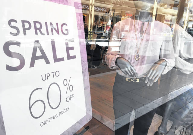 Merchandise is displayed at a store advertising a sale in April in Salem, N.H. There doesn't need to be an official sale for you to get a deal. Other ways to save include signing up for a retailer's email list, downloading the store app, using cash-back websites or just asking.